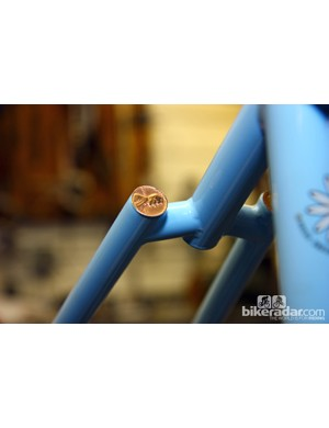 One long-standing Sycip trademark has been capping the seat stays with coins