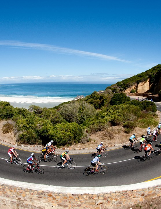 Cyclists on the Cape Argus Pick n Pay Cycle Tour at the start of the climb up Chapman's Peak. Noordhoek's Long Beach is in the distance