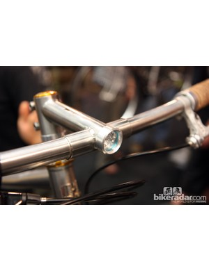 Sam Whittingham of Naked Bicycles integrated the front light right into the stem extension — clean and functional