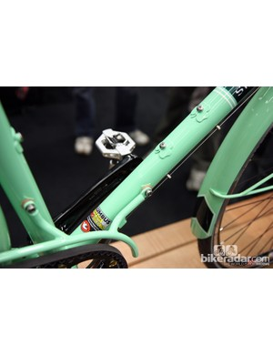 Leather washers in between the chain guard and frame protect the paint from metal-on-metal contact