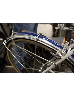 Traditional fender stays are eliminated in favor of a dual-purpose lowrider rack on this Steve Rex bike. Check out the polished fenders with the painted center stripe, too
