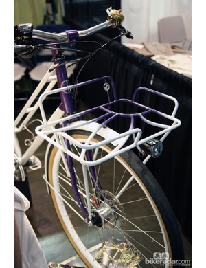 Look familiar? This front rack design is a further evolution of the sunflower bike Yipsan did last year, this time painted in purple and white and sporting a few additional details