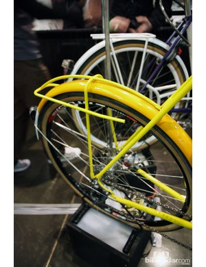 Many builders at NAHBS such as Renald Yip of Yipsan Bicycles were incorporating fender stays into overlying rack structures