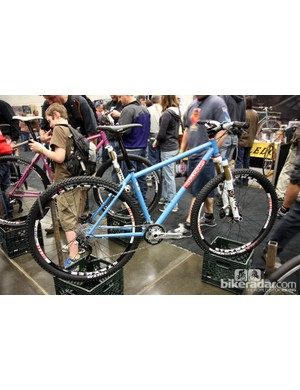 Soulcraft has added a new stock mountain bike model called Tradesman with standard geometry, a wishbone rear end, and a head tube decal instead of a proper badge. Retail cost for the frame is US$1,450 — a reasonable amount for a handbuilt chassis like this