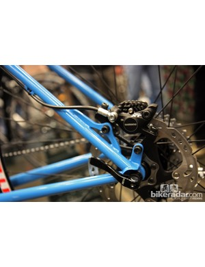 Soulcraft's two-piece disc caliper mount lends a minimal look to the rear end of this mountain bike