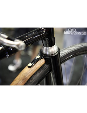 A small extension on the rear of the fork crown of the University of the Fraser Valley's 1888 Whippet reproduction provides the mounting point for a short wooden fender.