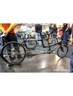 Craig Calfee brought his personal custom carbon fiber tandem to NAHBS. Calfee's son rides up front but Craig Calfee still enjoys an unimpeded view of the road plus full steering control courtesy of the custom pulley system.