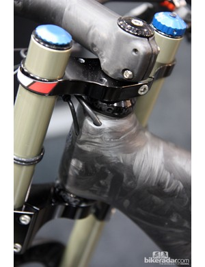The partially internal cable routing on Calfee's new 29er tandem feeds into the head tube.