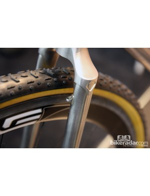 David Kirk of Kirk Frameworks fits this tidy housing guide to the front of his disc brake fork.