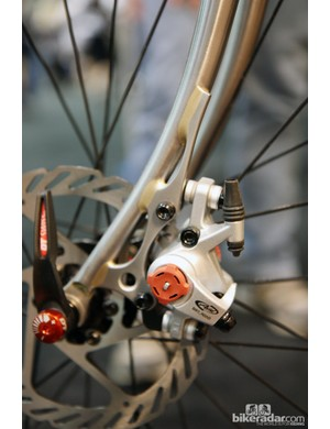 The elegant disc mount on this Kirk Frameworks steel fork spreads the load out over a lot of surface area and the tangential contact points prevent the tube from crumpling.