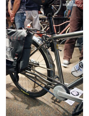 Check out how the single titanium rod serves as both the lower pannier support and the fender mount on this Ti Cycles machine.