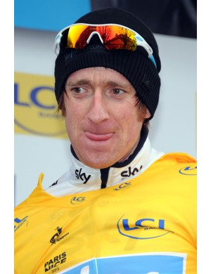 Bradley Wiggins on the podium in yellow