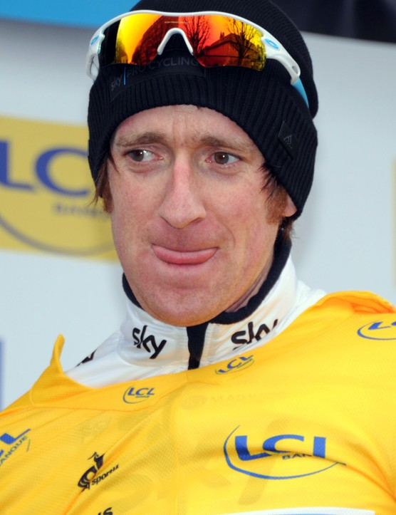 Bradley Wiggins on the podium in yellow