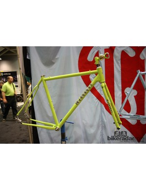 Chris Igleheart showed this bright adventure road frameset at NAHBS, featuring front and rear disc brakes, his own segmented fork, and pivoting rear dropouts