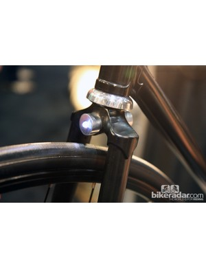 The switch on Cykelmageren's LED light is magnetically operated so the light automatically turns on when inserted into either the bar or fork crown