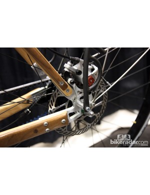 The aluminum plate dropouts are bolted in place on Renovo's wooden bicycle frames