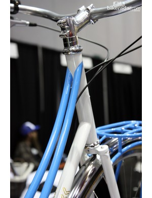 Twin top tubes arc gracefully away from the head tube on this Muse Cycles mixte