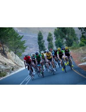 Platt, in the yellow jersey, heads up the peloton