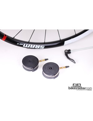 SRAM do include rim strips with the wheels for tubeless conversion
