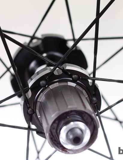 Steel freehub body; note the rubber stoppers at the hub flange meant to keep the spokes from ejecting