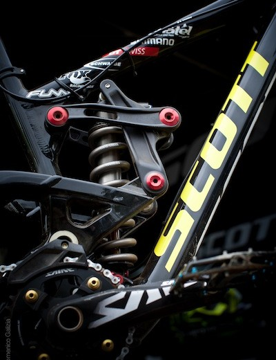 The shock linkage, which controls the shock rate for what appears to be single pivot bike