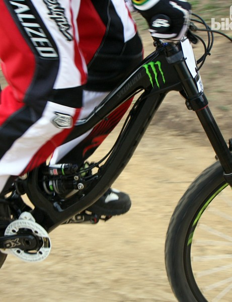 Monster Energy-Specialized gave Sam Hill's new race bike a stealthy black finish but we still noticed the new carbon fiber front triangle