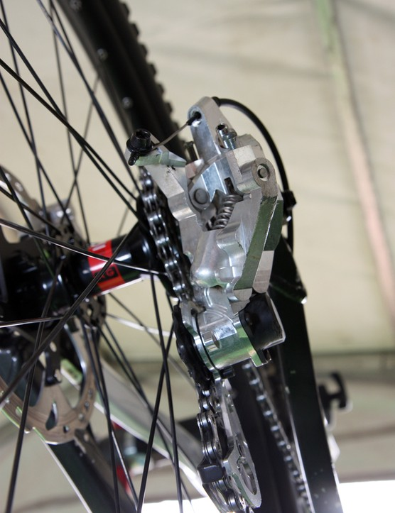 The large lower knuckle on Aaron Gwin's (Trek World Racing) prototype Shimano Saint Shadow Plus rear derailleur houses the friction mechanism to control the pulley cage
