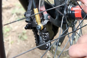 Some Trek World Racing downhill bikes were fitted with more production-ready versions of Shimano's revamped Saint four-piston brake caliper - but with logos blacked out, of course. Note the more open back, two instead of four bolts holding the caliper halves together, and the more sculpted body