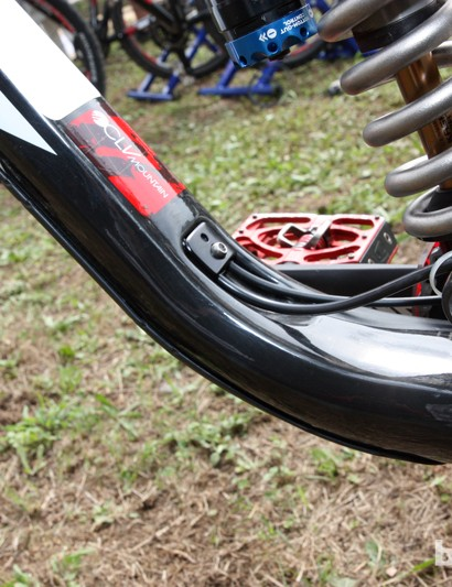 The rear derailleur housing and rear brake hose exit the down tube just ahead of the bottom bracket shell