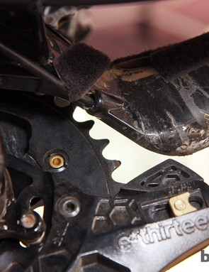 The rear derailleur housing is fed into the front of the chain stay…