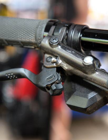 The blacked-out logo is hiding the badges for Shimano's revamped Saint lever