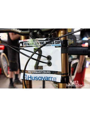 Teams often get creative in mounting number plates on downhill bikes