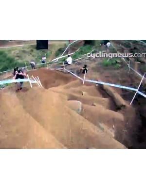 Craig navigates a steep stair section