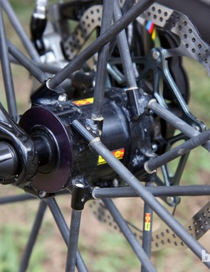 The massive alloy hub shell on Jean-Christophe Peraud's Crossmax Ultimate front wheel anchors hollow carbon fiber spokes.