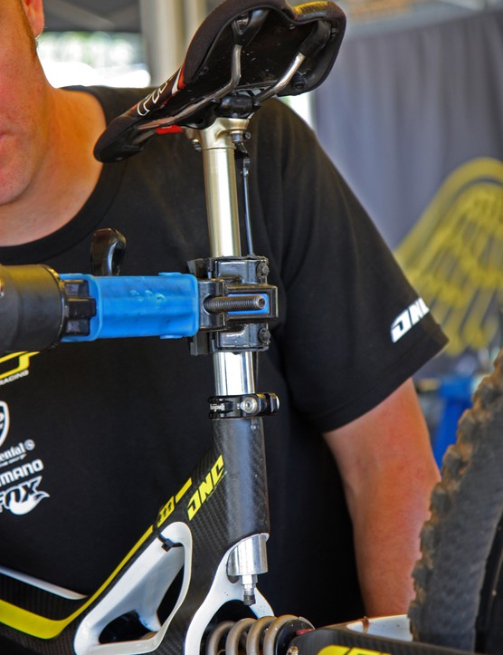A Fox Racing Shox DOSS post on a GT team bike. Note the exposed air valve on the bottom of the post