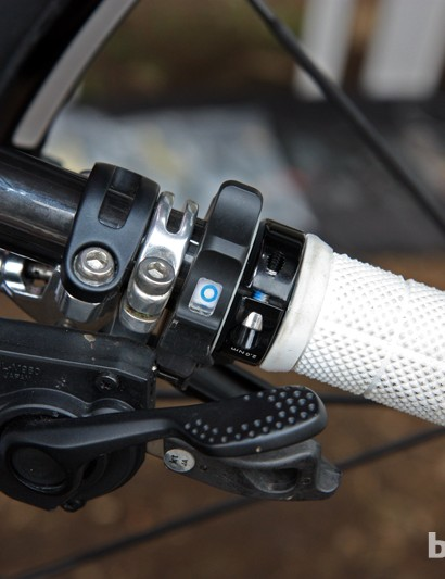 The small rotary remote of Fox's new electronically controlled fork takes up hardly any room on the bar