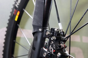 One of the few disadvantages of Cannondale's Lefty fork layout is the need to unbolt the front brake caliper if you need to remove the front wheel - though the single-sided design means you can repair flats without having to do so