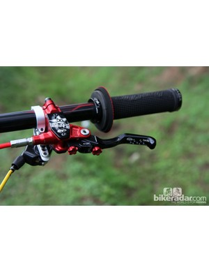 The drilled-out blades provide just a hint of extra traction on Cedric Gracia's (CG Racing Brigade) Hope brake levers