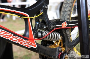 The Fox Racing Shox DHX RC4 rear shock is neatly tucked away low on the chassis