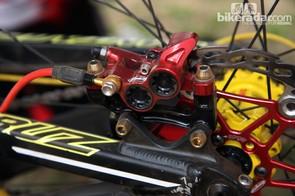 Four-piston Hope calipers with titanium hardware on Cedric Gracia's (CG Racing Brigade) Santa Cruz V-10 Carbon