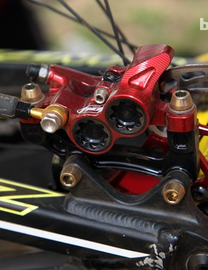 Four-piston Hope calipers with titanium hardware on Cedric Gracia's (CG Racing Brigade) Santa Cruz V-10 Carbon
