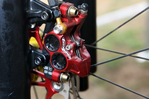 Whereas the rear brake caliper is fitted with titanium bolts exclusively, a mix of titanium and steel is wisely used on the front caliper