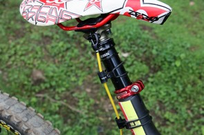A Fox DOSS dropper seatpost and a custom finished saddle atop Cedric Gracia's (CG Racing Brigade) Santa Cruz V-10 Carbon