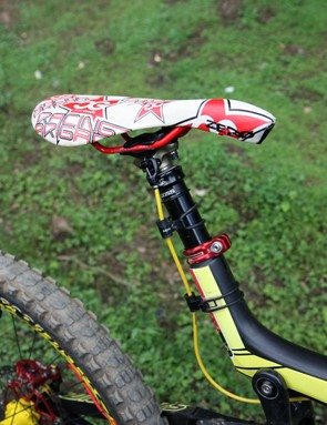 A Fox DOSS dropper seatpost and a custom finished saddle atop Cedric Gracia's (CG Racing Brigade) Santa Cruz V-10 Carbon