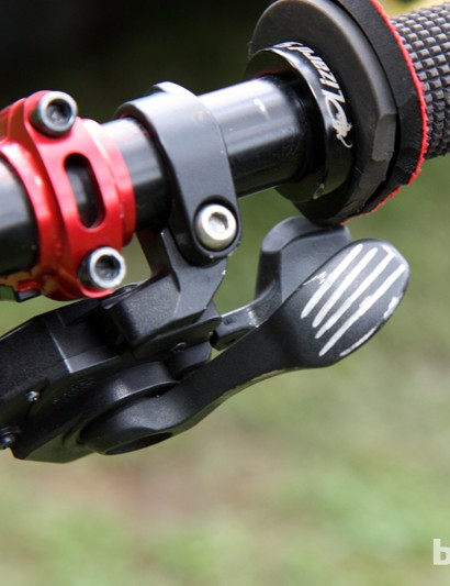 Mechanic Kevin Joly trims away the flange on Gracia's Lizard Skins grips to free up access to his Shimano Saint shifter