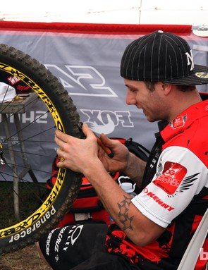 Cedric Gracia's (CG Racing Brigade) mechanic, Kevin Joly, clips tire knobs in anticipation of fast conditions