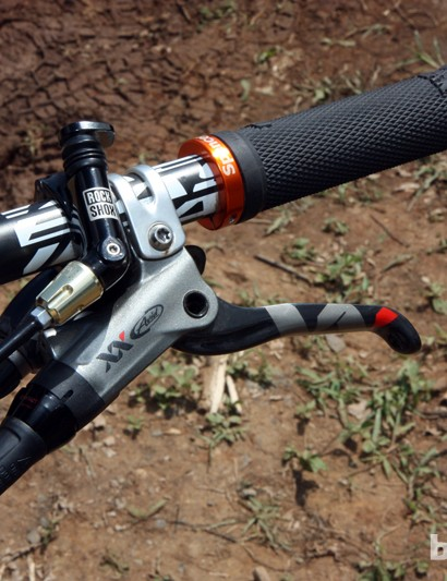 SRAM XX controls and custom etched lock-on grip collars on Spencer Paxson's Kona King Kahuna