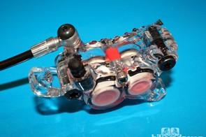 This plastic model shows the new Saint calliper's four pistons