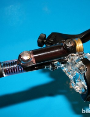 The new Saint master cylinder features a short lever and hinged bar clamp, as this plastic model shows