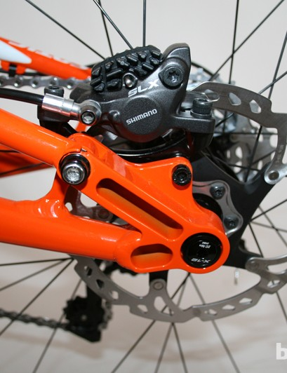 The upper brake post-mount is integrated with the chainstay pivot on the Cotic Rocket